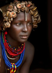 Ethiopia, Omo Valley, Omorate, Portrait Of A Young Dassanech Cute Woman Wearing Bottle Caps Headgear And Beaded Necklaces
