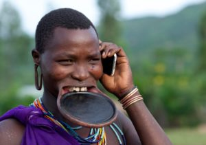 Ethiopia, Omo Valley, Tulgit, Suri Woman With Lip Plate And Mobile Phone