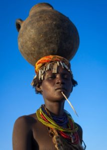 Ethiopia, Omo Valley, Omorate, Dassanech Tribe Woman With A Calabash On Her Head
