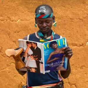 Young Fashionable Banna Man With Headrest Reading Vogue French Magazine Ethiopia