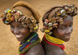 Ethiopia, Omo Valley, Omorate, Two Young Dassanech Girls Wearing Bottle Caps Headgear
