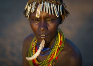 Ethiopia, Omo Valley, Omorate, Dassanech Tribe Woman With A Feather In The Chin